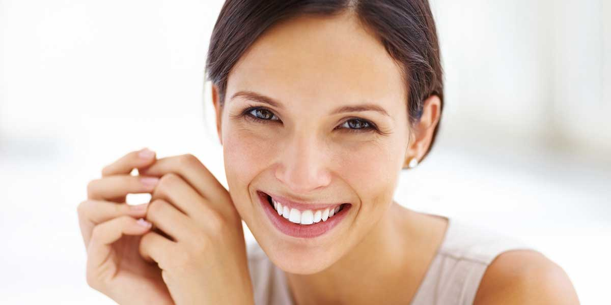 Woman Smiling After Smile Makeover