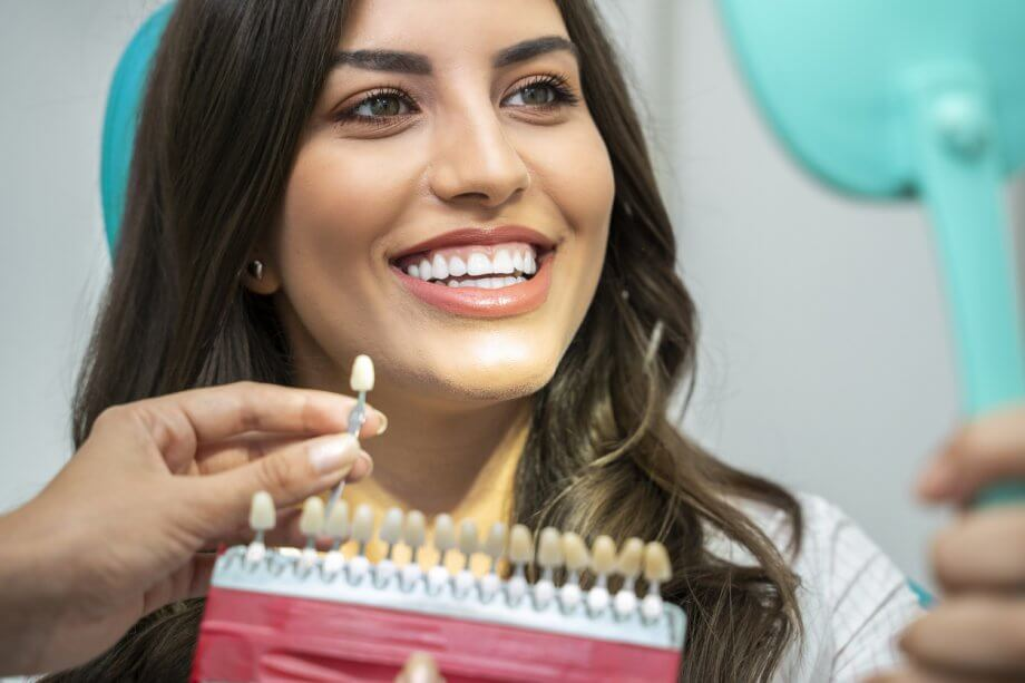 woman reviewing teeth with doctor