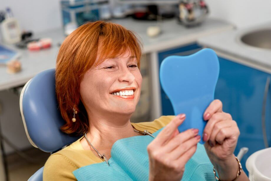 senior woman smiling at dentist